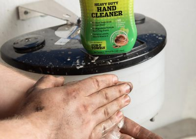 Hands using Tub O' Scrub