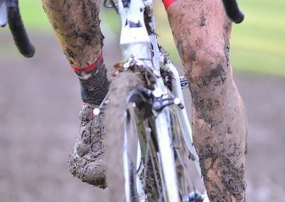 Bicycle chain with mud in a race